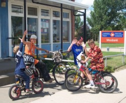 Local children on bicycles.