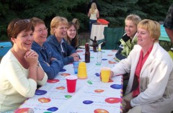 Residents laughing at picnic.